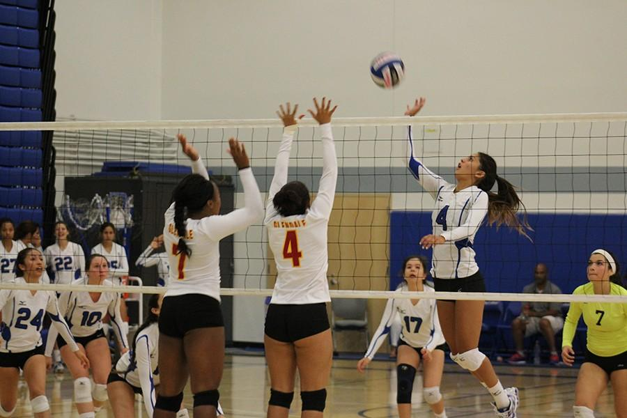 Nicole Spigner jumps to just tap the ball to the other side. Spigner had a team high of 8 kills. Photo credit: Christian Gonzales