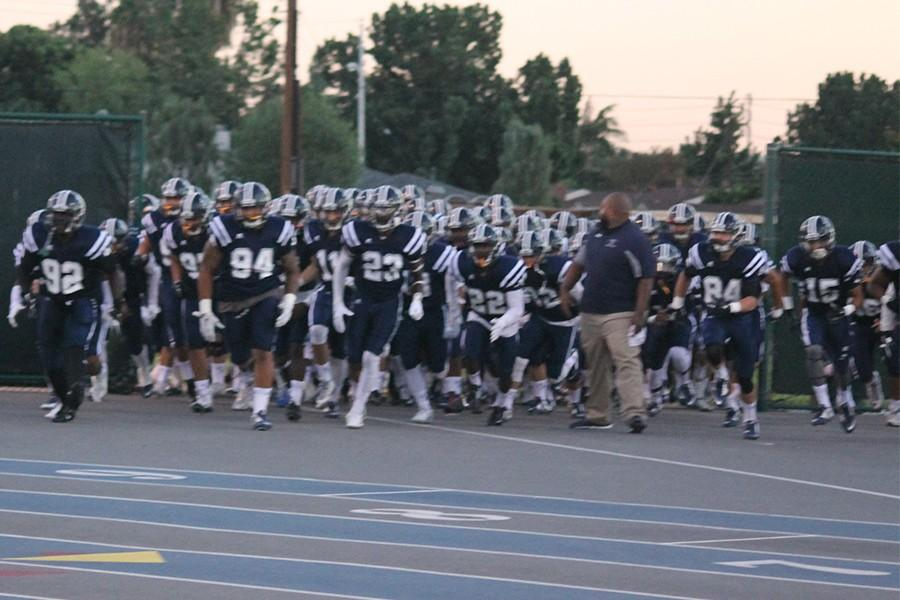 The Falcons charge onto the field at the start of the game to begin the home slate of the 2015 season. Cerritos struck first but let it slip away in the second half. Photo credit: Taylor Ogata