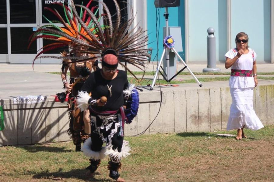 Fernanda Gonzales and the Ollin itotiani dance group perform a traditional aztec dance at the Cerritos College Amphitheater. Fernanda Gonzales is a former student of Cerritos College Photo credit: Vanessa Villasenor