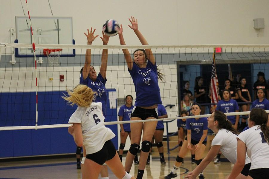 Natalie+Caravantes+%28left%29+and+Kayley+Stephens+%28right%29+jump+to+block+the+shot+from+%236+of+Fullerton.+The+Scrimmage+helped+the+volleyball++team+prepare+for+Friday%27s+Sept.+4+game.+Photo+credit%3A+Christian+Gonzales