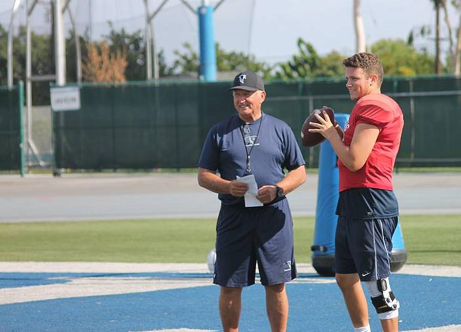 Head coach Frank Mazzotta (left) keeping a close eye on starting quarterback Jimmy Walker (right) during practice. Mazzotta on Walker,