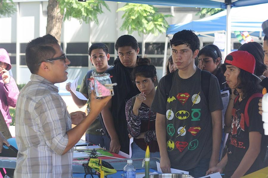 Aerodynamics Club member, Jesus Martinez, demonstrates some of the projects the club will work on, to some visiting high school students.