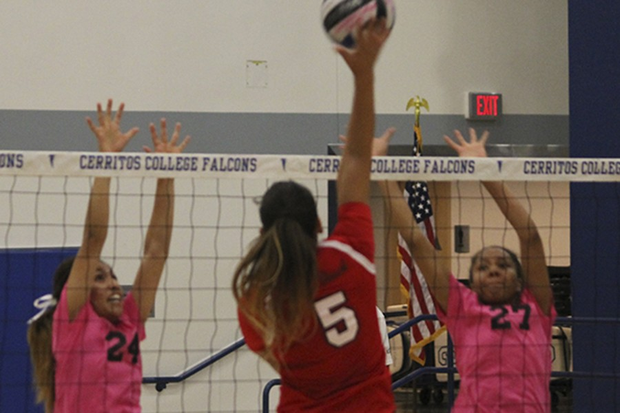 Natalie Caravantes (#24) and Jasmine McNeal (#27) jump at the net to try and block a kill attempt from Long Beach Citys Lauren Christensen (#5). Caravantes led the Falcons with 32 assists while McNeal had two kills in the match. Photo credit: Taylor Ogata