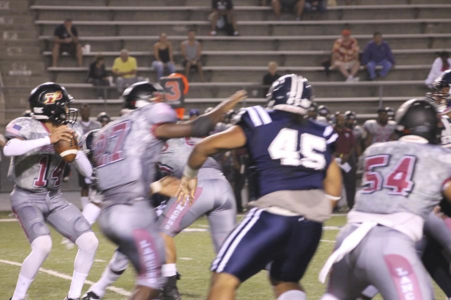 David Fangupo (#45) tries to sack Pasadena quarterback Marc Peart (#14). Fangupo had two tackles in the game. Photo credit: Taylor Ogata