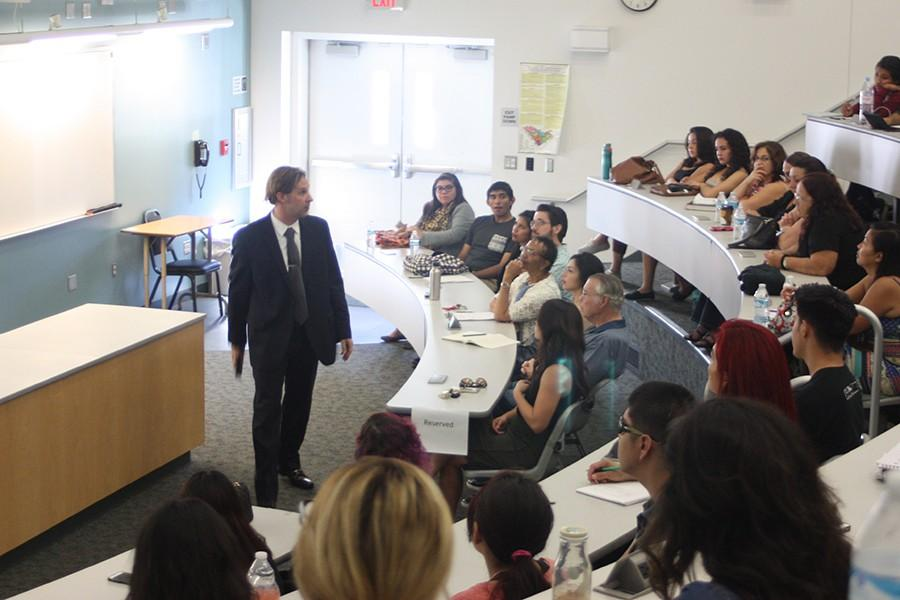 Room S201 is filled with students  as Dr. Shug gives his persecution on psychopathy and serial homicide. Approximately 90 students attended the event. Photo credit: Kristopher Carrasco