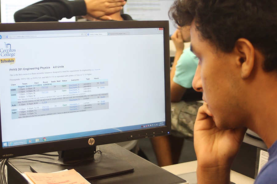 On Thursday, Oct. 15, K16 bridge program held a workshop for freshman, so that they can learn how to enlist for classes. Adrian Rodriguez, freshman and math major, was one of the sudents in attendance. He is looking for what classes to take next semester. Photo credit: Grester Celis-Acosta