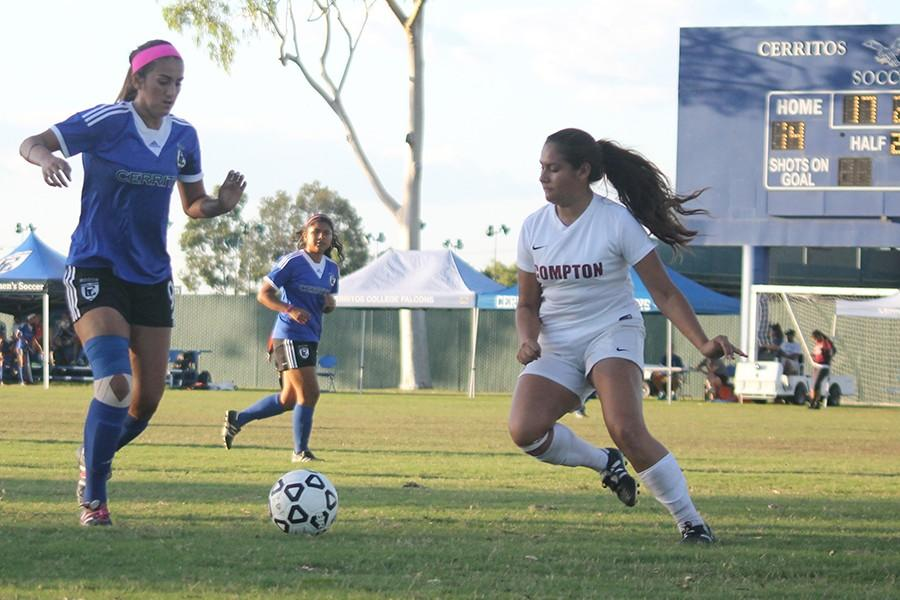 Forward, Natalie deLeon, attempts to get past a Compton-Center defender, deLeon scored 3 goals and made 3 assists. The Falcons broke two records in the course of the game.