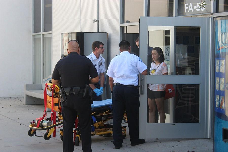 Campus police and paramedics respond to a call in FA-55 regarding a student faiting while in class. Officer Carlo Velasquez stated that the student is okay and did not want to go to the hospital.