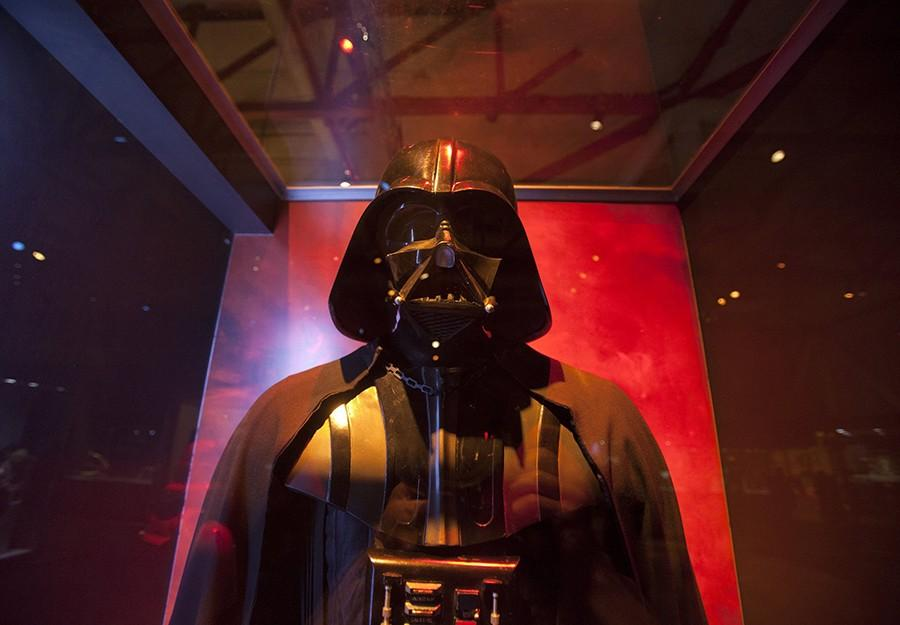 """An original Darth Vader costume is one of the displays in """"Star Wars: Where Science Meets Imagination,"""" at the Tech Museum of Innovation in downtown San Jose, California, on Tuesday, October 15, 2013. The pop culture extravaganza, which stars a life size replica of the Millennium Falcon cockpit among other geek Holy Grails from the """"Star Wars"""" universe, brings the George Lucas mythos back home to the Bay Area where it all began. (Patrick Tehan/Bay Area News Group/MCT)"""