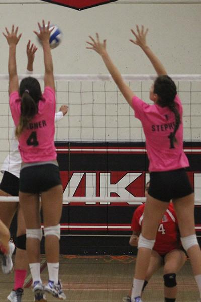 Nicole Spigner (#4) and Kayley Stephens (#1) try to block a kill attempt from Long Beach. Spigner had six kills and six digs in the match while Stephens finished with nine kills. Photo credit: Taylor Ogata