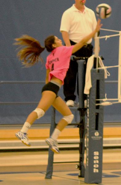 Nicole Spigner (#4) tips the ball over the net for a kill. Spigner once again led the Falcons with eight kills and 14 digs. Photo credit: Taylor Ogata