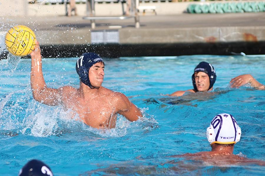 Isareal Rodriguez a driver for the Men's waterpolo team attempts to make a shot against their game against Los Angeles Trade-Tech. At the end of the game he coined two goals for the Falcons win against the Beavers. Photo credit: Vanessa Villasenor