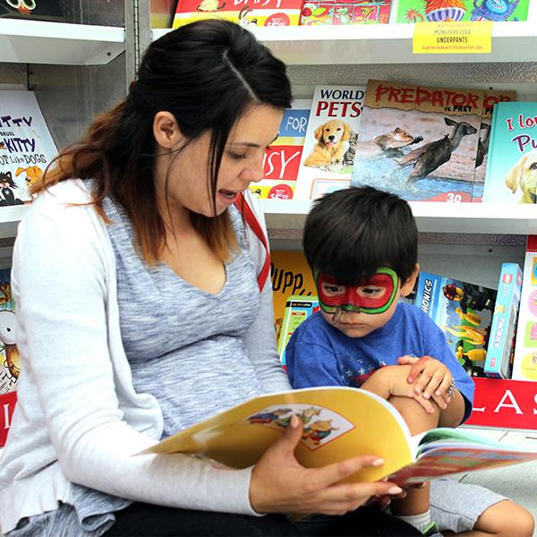 Expecting mother, Christina Phillips (left) reads 'Llama Llama and the Bully Goat' by Anna Dewdney to her son Owen Phillips (right). Photo credit: Bianca Salgado