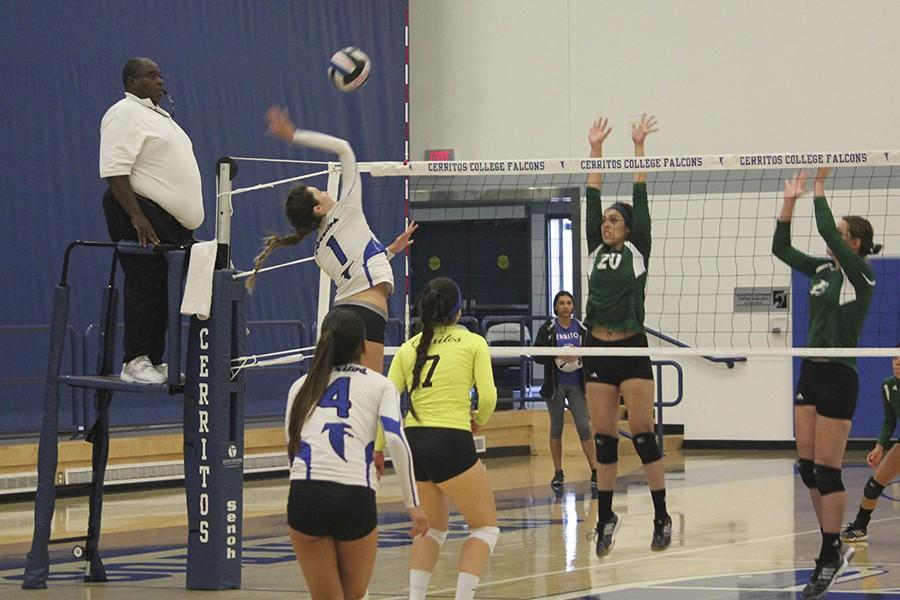 Kayley+Stephens+%28%231%29+hits+the+ball+off+the+fingertips+of+Ashley+Winet+%28%2320%29+of+East+Los+Angeles.+Stephens+finished+the+match+with+seven+kills.+Photo+credit%3A+Taylor+Ogata
