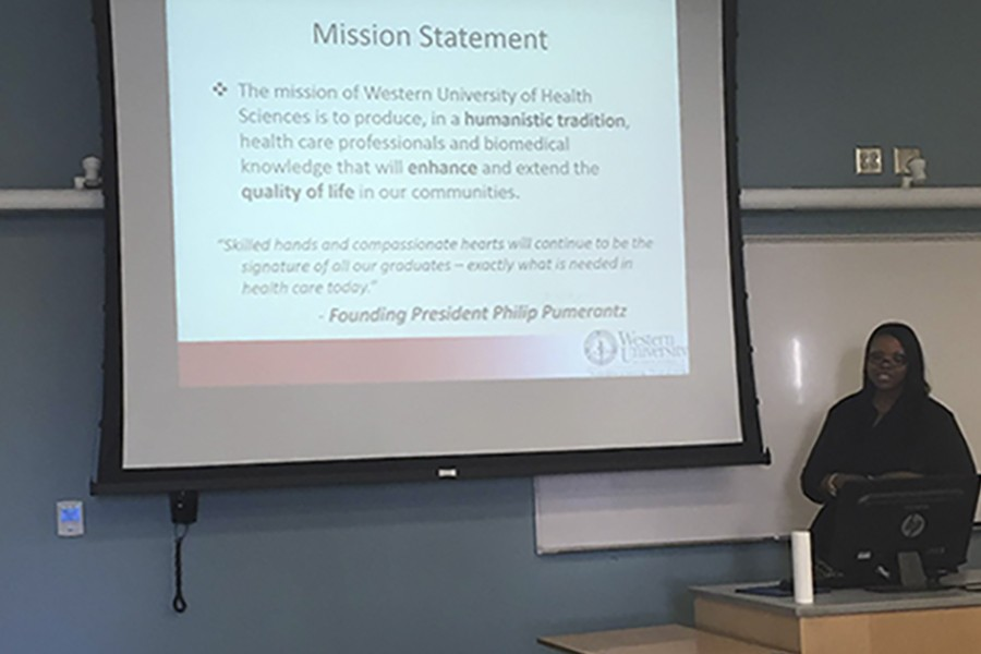 Robin Johnson, university recruiter, gives a presentation about the College of Veterinary Medicine. She explains the mission statement the school follows. Photo credit: Ethan Ortiz