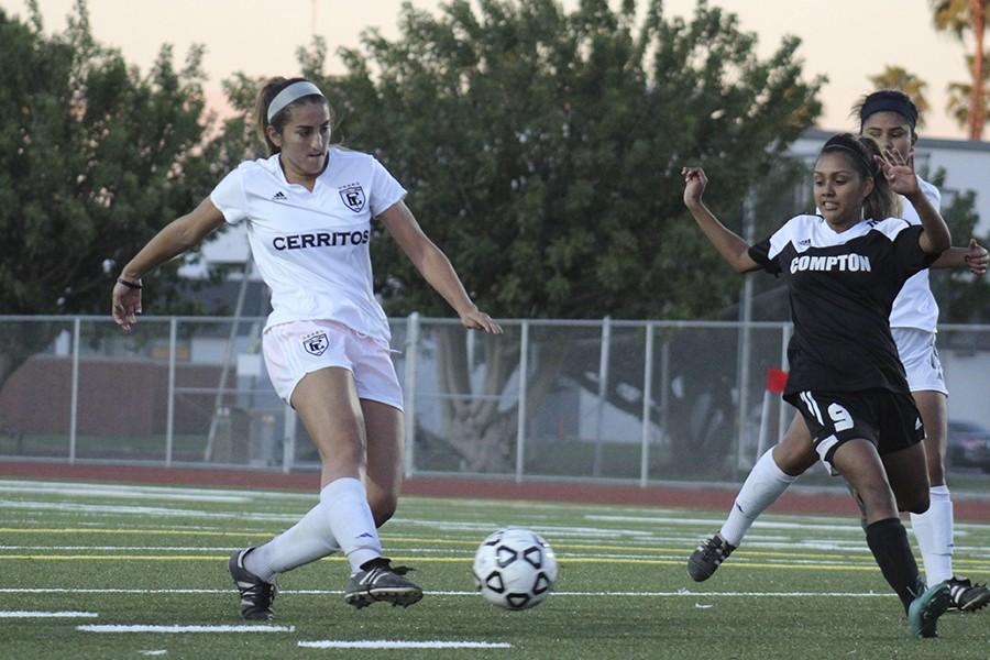 Freshman Natalie deLeon shoting the ball in the box. deLeon leads Cerritos with 20 assists of the season. Photo credit: Christian Gonzales