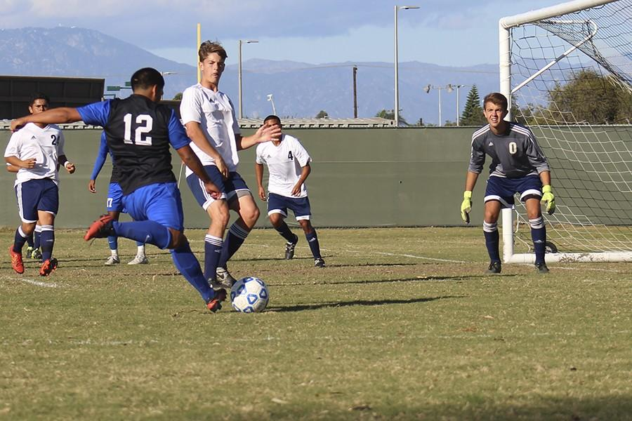 Sophomore+Cesar+Armendariz+shoots+on+goal+but+his+shoot+went+over+the+goal.+Cerritos+had+two+shots+on+goal+against+El+Camino+College.+Photo+credit%3A+Christian+Gonzales