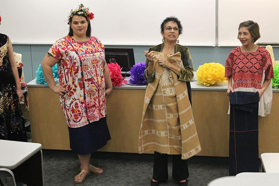 Genevieve Barrios uses students models to show off the traditional Mexican fashion. The fashion show is a way to educate people about other cultures as part of a series for international education week. Photo credit: Vanessa Villasenor