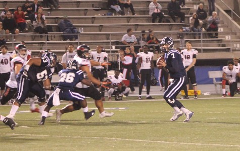 Jimmy Walker (#7) drops back to pass. Walker connected on eight of 23 passes for 134 yards and threw a touchdown as well as three interceptions on the night.