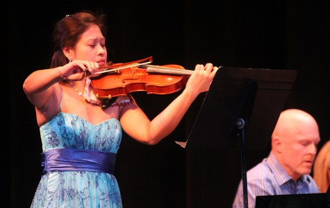 Tammy Tsai, a music instructor, performing the violin alongside Brice Russell on the piano. The duo performed Johannes Brahms in the Faculty Gala on Sunday, Nov. 15.