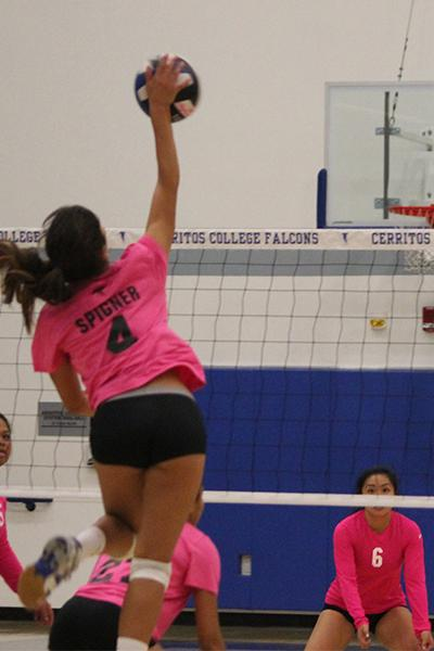 Nicole Spigner (#4) hits the ball over the net on the third touch. Spigner led the Falcons in digs with 19 along with 15 kills. Photo credit: Taylor Ogata