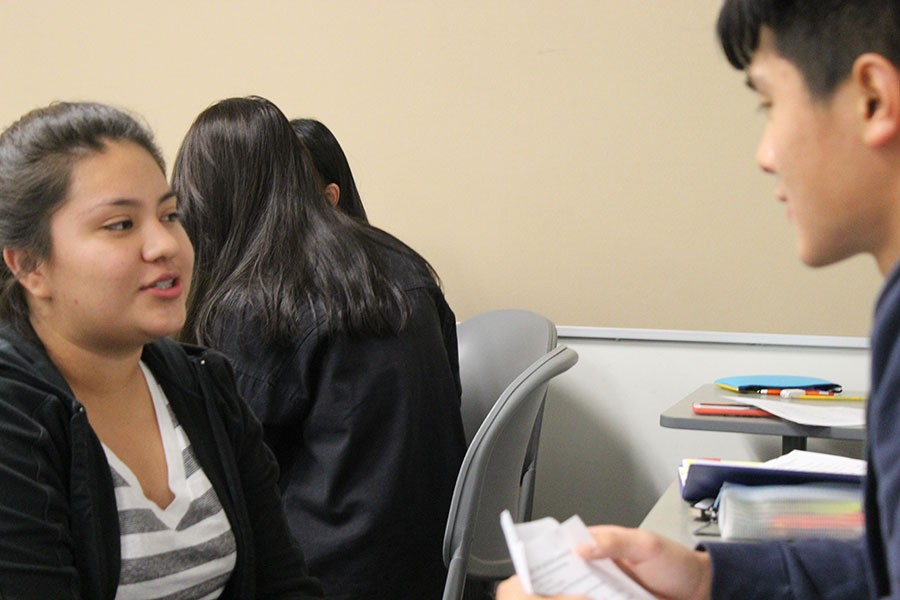Students break out into small groups of two to practice interview skill. Xi Zhang, international business major, listens as Wendy Mendoza, nursing major, talks about her qualifications. Photo credit: Frank Rodarte