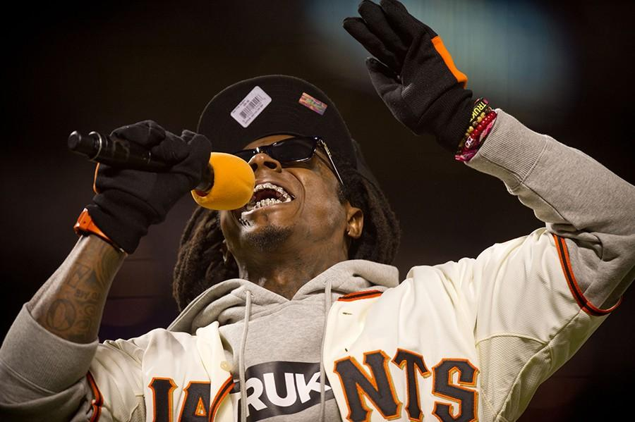 """Rapper Lil Wayne performs """"Take me out to the Ballgame"""" during Game 6 of the National League Championship Series at AT&T Park on Sunday, October 21, 2012 in San Francisco, California. The Giants won, 6-1. (Jose Luis Villegas/Sacramento Bee/MCT)"""