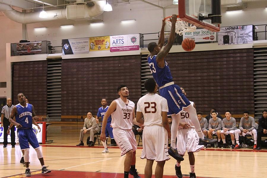 Jamal Watson (#33) throws down a two-handed dunk with authority. Watson finished the game tied for the team high in scoring with 16 points. Photo credit: Taylor Ogata