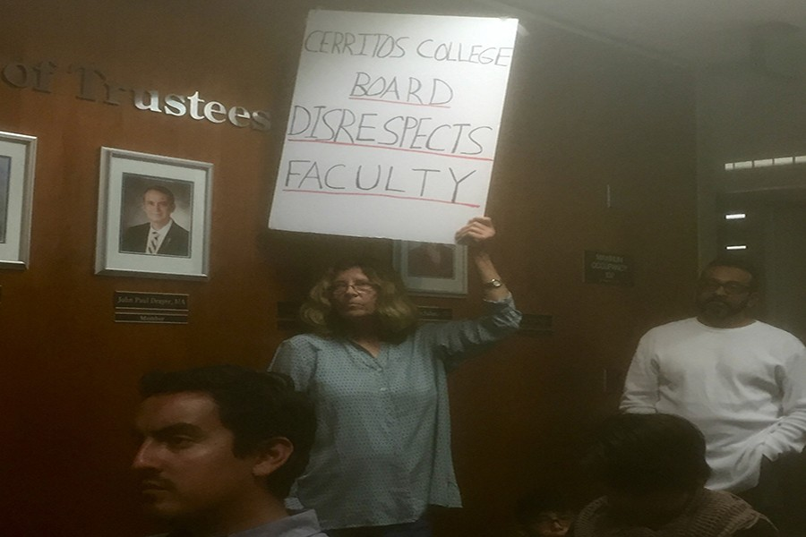Sociology professor Diane Pirtle holds sign showing her dissapointment with the Cerritos College Board of Trustees over faculty wages. She was also present at the Dec. 9 board meeting where other faculty members took over public comment to discuss wages.