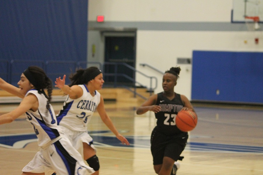 Kaylyn+James+%28%2325%29+defends+against+Deloice+Johnson+%28%2323%29+of+El+Camino-Compton.+James+finished+with+six+points+along+with+three+rebounds%2C+and+an+assist.