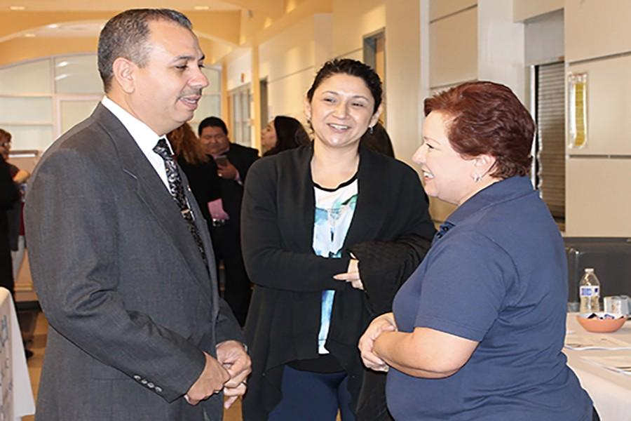 Senator Tony Mendoza speaks with Toni Grijalva, Coordinator of Community Relations for Cerritos College, at the Community Health Fair held at the student center on January 23. Deadline for open enrollment with Covered California is January 31st. Photo credit: Chantal Romero