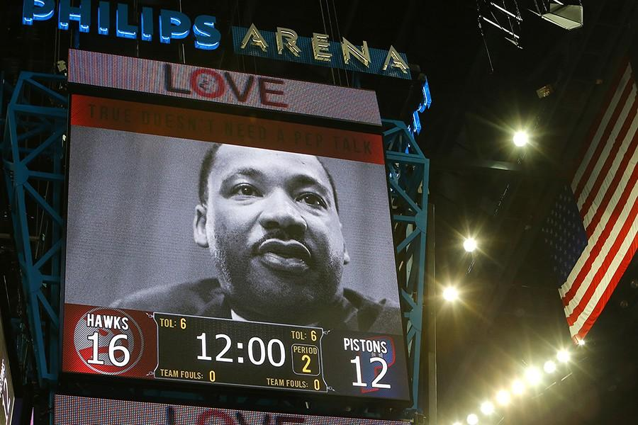 The Hawks honor Martin Luther King Jr. during the first half of the basketball game against the Pistons on Monday, Jan. 19, 2015, at Philips Arena in Atlanta. The Hawks beat the Pistons 93-82 for their 13th victory in a row. (Curtis Compton/Atlanta Journal-Constitution/TNS)