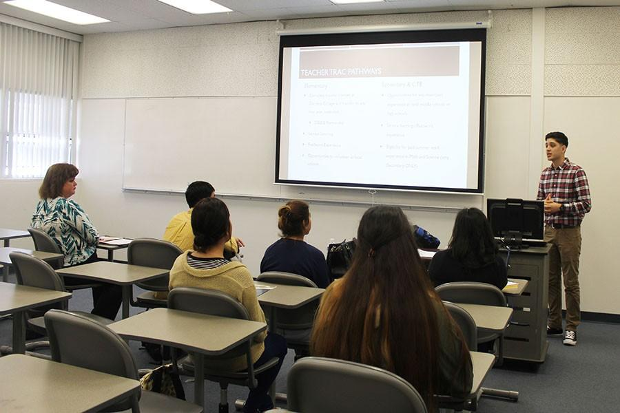 Matthew Botello, current Teacher TRAC participant, explains to incoming students the different teaching pathways that the program offers. The program accepts applications every semester, and there is no limit to how many can join. Photo credit: Chantal Romero