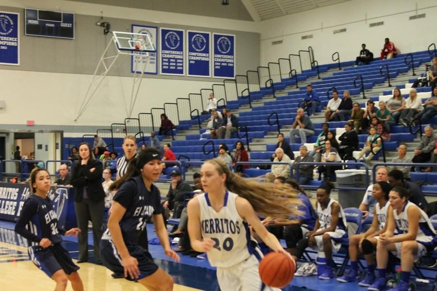 Allyson OBrien (#20) catches Elise Allison (#24) of El Camino flat-footed and blows right by her to the rack. OBrien led the Lady Falcons with 18 points, 13 of them coming in the second half. Photo credit: Taylor Ogata