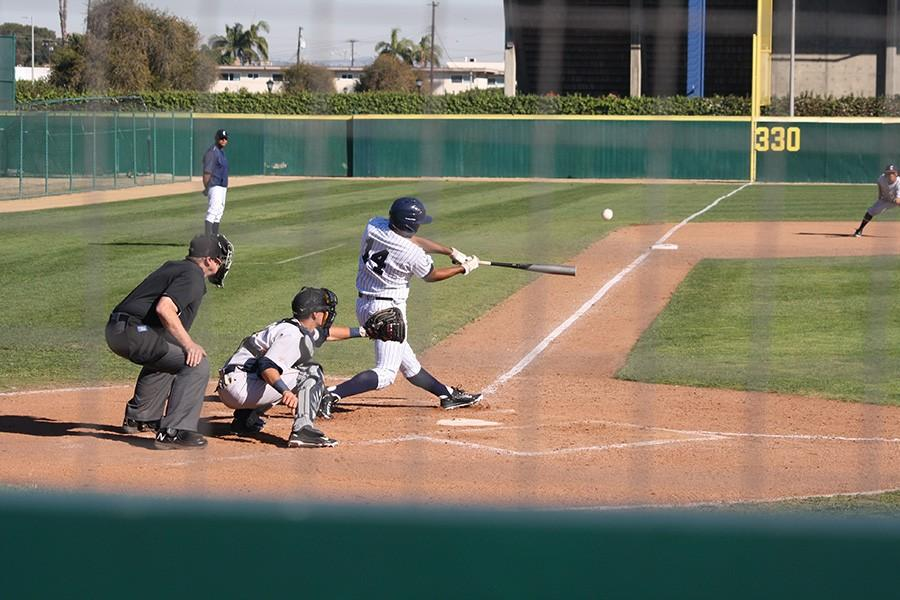 Fermin Beza (#14) uses a strong swing to take Citrus pitcher Trevor Fisher deep for the Falcons' first home run of the season. Beza went 2 for 3 on the day. Photo credit: Taylor Ogata