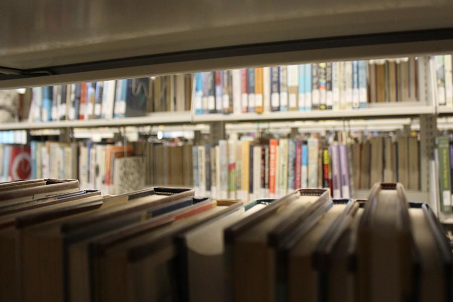 Physical books dominate over e-books for many reasons. There is nothing like the feeling of flipping pages and opening a textbook. Photo credit: Jenny Gonzalez