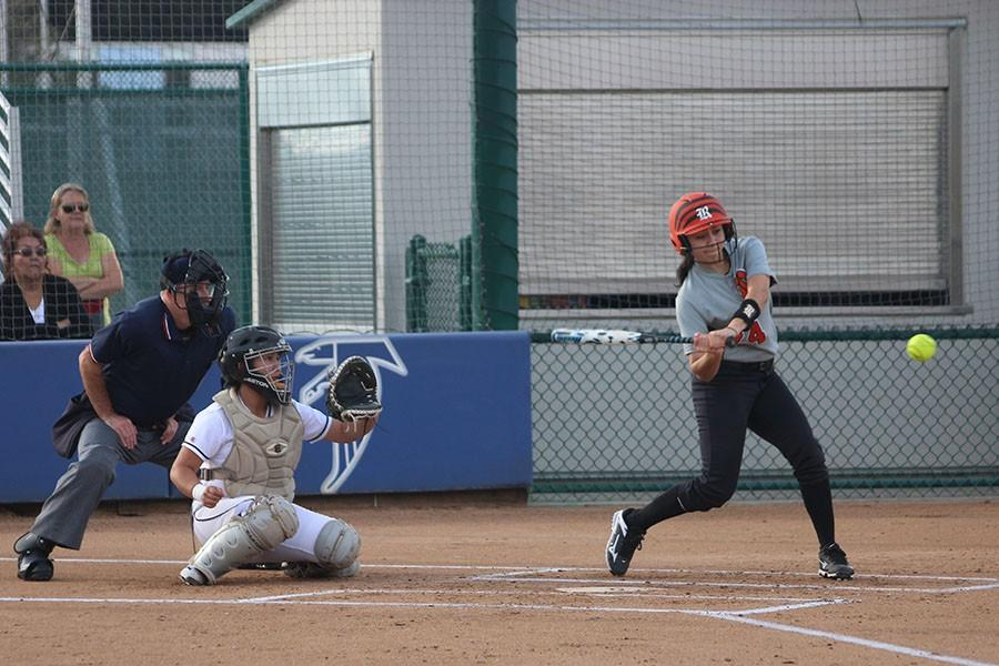 Catcher, Jessica Martinez, readies herself for for a pitch. She is on the receiving end of a strike thrown by pitcher, Jenny Navarro. Photo credit: Monique Nethington