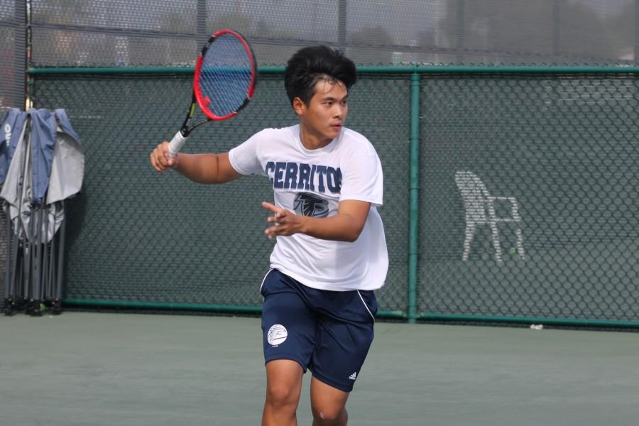 James Zhang getting ready to swing and send his opponent to a loss. Zhang won his singles competition in straight sets but lost in doubles. Photo credit: Miguel Meza