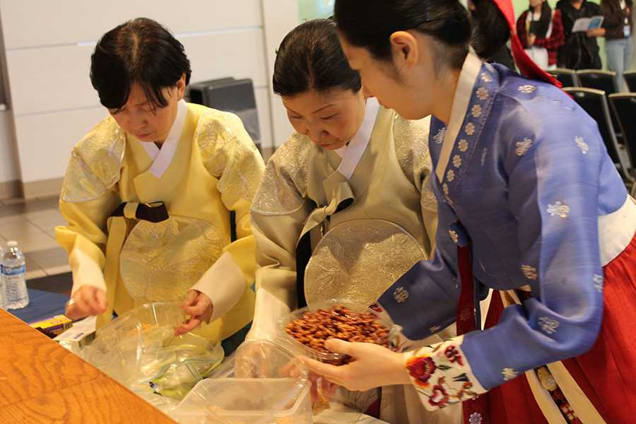 Members of the Korean Women's Group preparing food for guests at the Taste of Korea event in the Student Center on Wednesday, March. 23. The event had performers and informational videos to showcase Korean culture. Photo credit: Janel Oliver