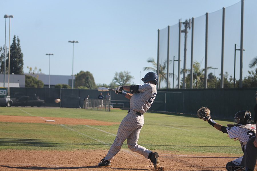 Mark+Pena+lines+a+base+hit+up+the+middle+into+center+field.+Pena+went+2-for-5+with+an+RBI+in+game+one.+Photo+credit%3A+Taylor+Ogata