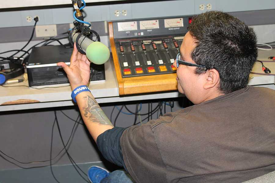 Rob Flores working in the studio at WPMD. His show was deemed the best Student Public Affairs Radio Program in America by The Intercollegiate Broadcasting System. Photo credit: Janel Oliver