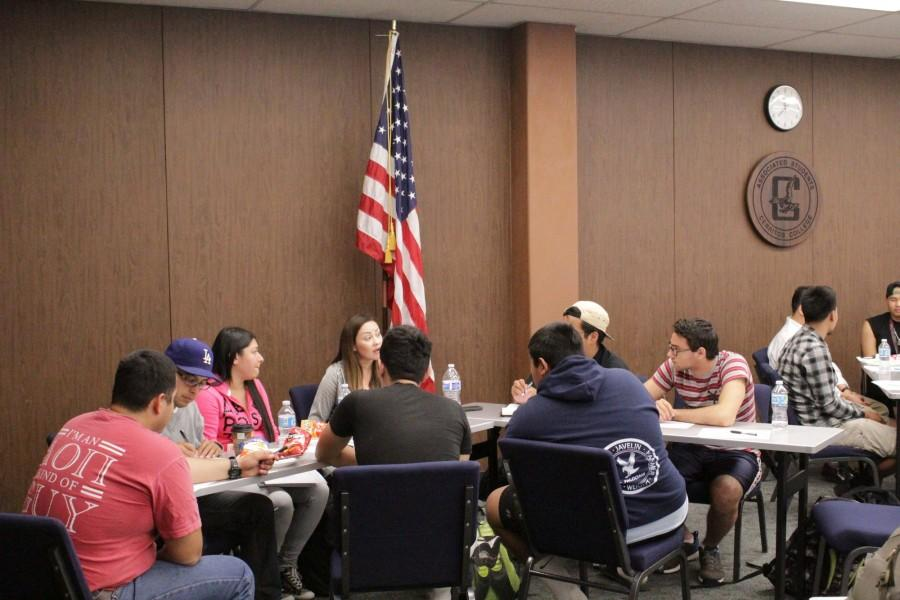 Clubs gather around for the Inter Club Council meeting to discuss how to make the clubs run better. Many students sat at a table together to discuss the issues they were having. Photo credit: Tisha Lenon