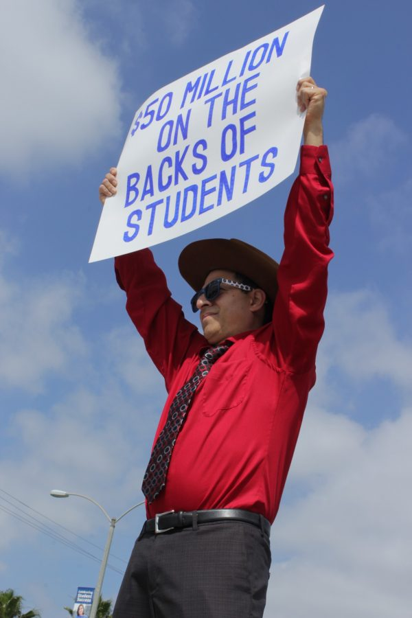 Business professor Jerry Ramos holds a placard at the Faculty Federation rally on Wednesday, May 4 on Studebaker and Alondra. The rally moved on to the administration quad at 5:30 and ended at the Cheryl A. Epple Board Room. Photo credit: Karla Enriquez