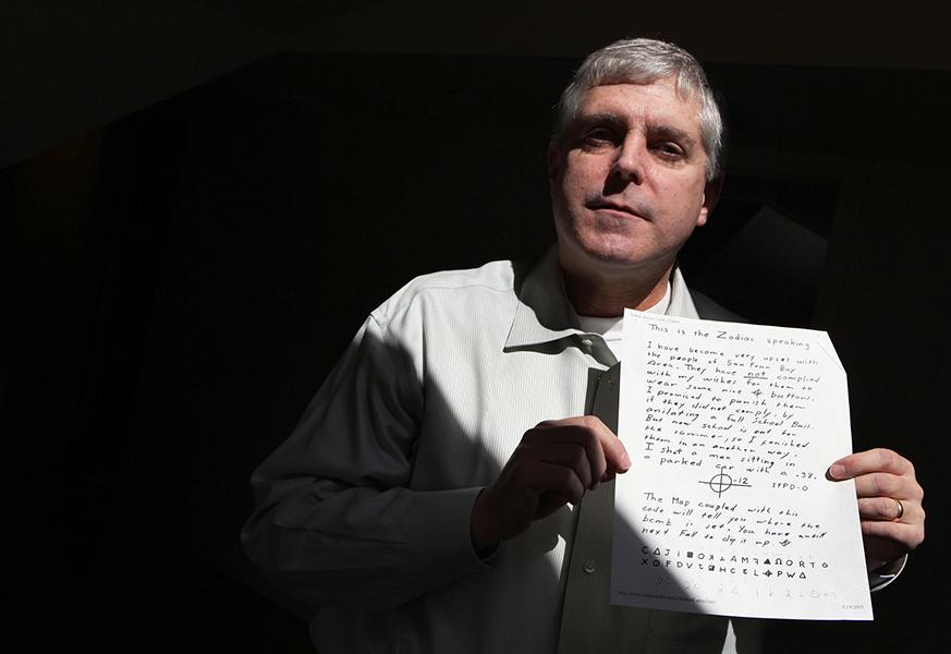 Chicago Police Lt. John Lewison, at his Chicago home, March 25, 2011, spreads out copies of a map, codes and other clues left behind by a notorious Los Angeles killer who eluded detection in the 1960s and 1970s. Lewison has taken an interest in trying to solve the cryptograms left by the notorious Zodiac killer, puzzles that that he believes may contain his identity and other vital information about him. (Antonio Perez/Chicago Tribune/MCT)