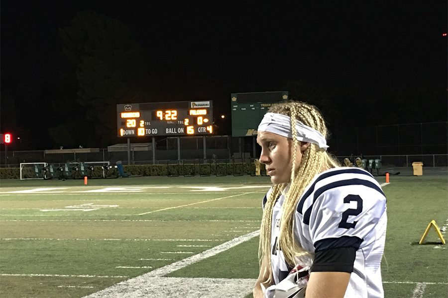 Wide receiver Landon Jones looks on as the Falcons trail 20-0. The Monarchs would eventually win the game by a score of 23-7. Photo credit: Terrel Emerson