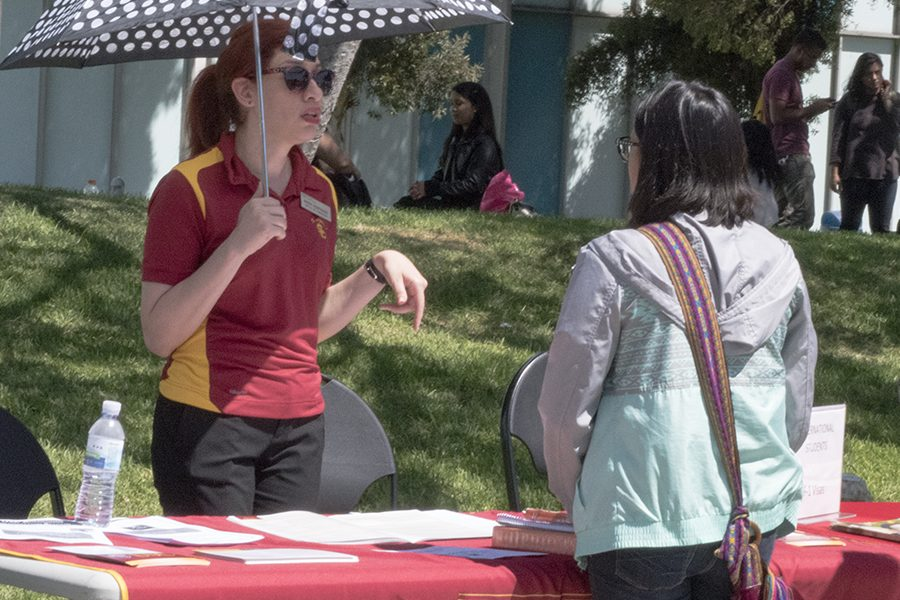 Admissions counselor Maria Rodriguez giving advice to theatre major Amy Palma. Palma was interested in USC and picked up the handouts available to take home. Photo credit: Perla Lara
