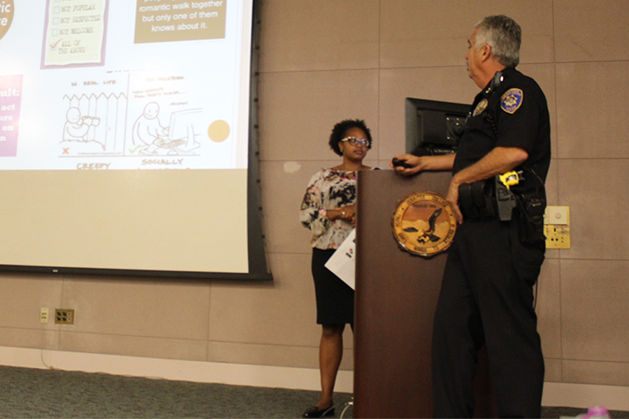 Chief Tom Gallivan explaining domestic abuse and other kinds of abuse alongside Title IX Coordinator Valyncia Raphael. Talon Marks staff writer David Jenkins was the only person at the Falcon Safe presentation on affirmative consent on Tuesday, Sept. 20. No other students showed up for the presentation. Photo credit: David Jenkins