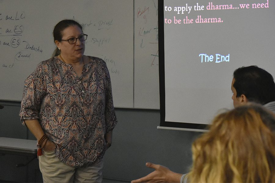 Philosophy+professor+Kim+Berling+engaging+in+a+discussion+on+Buddhism+and+environmental+ethics+with+students+who+attended+her+presentation+on+Tuesday+Sept.+6.+Berling+explained+and+criticized+what+Ecological+Buddhism+is+and+gave+her+thoughts+as+a+scholar+of+Buddhism.+Photo+credit%3A+Perla+Lara