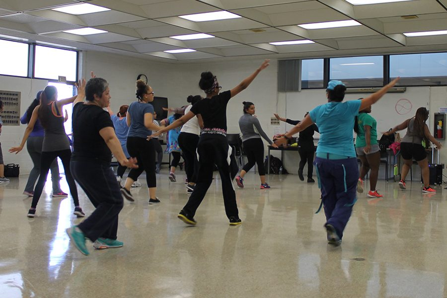 Martha Robles enjoys the second day of zumba class. Instructor Paola uses different tactics to dance away. Photo credit: Leslie Castaneda