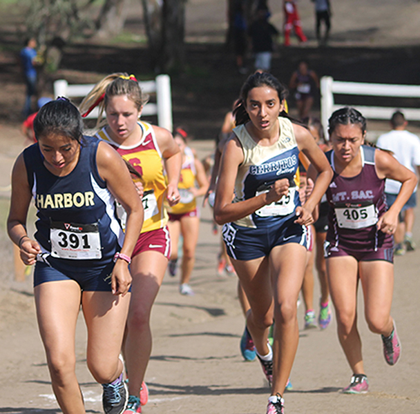 Sophomore Adrianna Velasco pushes through a pack of runners on the back hill of Central Park (HB.) Both the men and women would compete in the Golden West Central Park Classic.